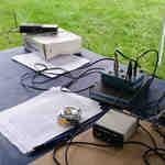 Field Day operating position featuring an Icom IC-2AT and AEA PK-88 for NTS messages.