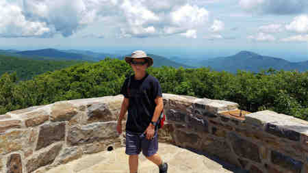 Dylan explores the top of Hawksbill Mountain.
