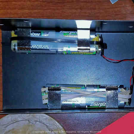 The MFJ-259 SWR Analyzer battery holders.