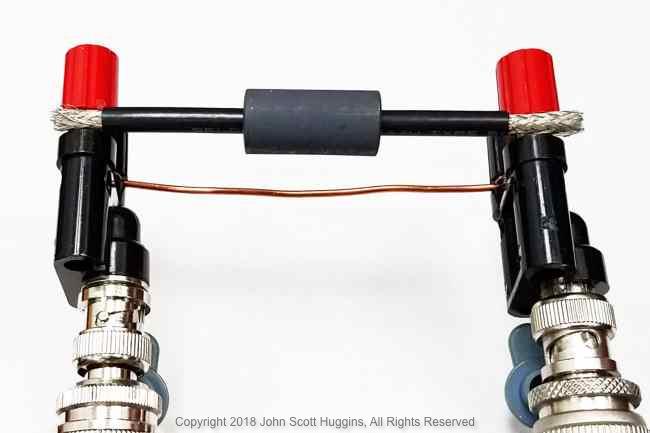 Fair-Rite 2661480002 Type 61 Ferrite Slide-on Choke in center position.